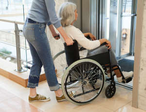 woman-care-for-disabled-patient-FGUVYT7_1900px